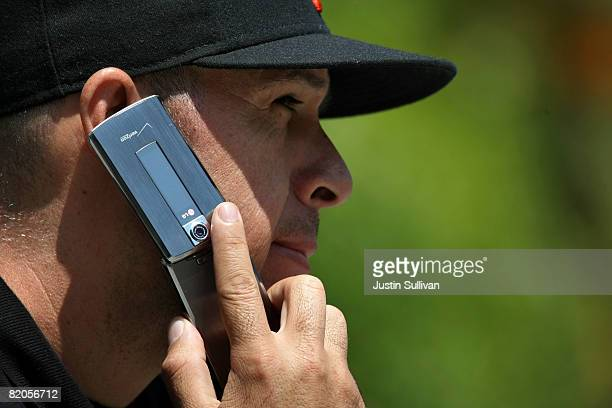 Sal Mora talks on his cellular phone as he sits in a park July 24 2008 in San Francisco California Dr Ronald B Herberman director of the University...