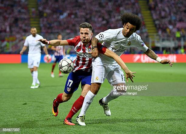 Saúl Níguez of Atletico Madrid battles for the ball with Marcelo of Real Madrid during the UEFA Champions League Final match between Real Madrid and...