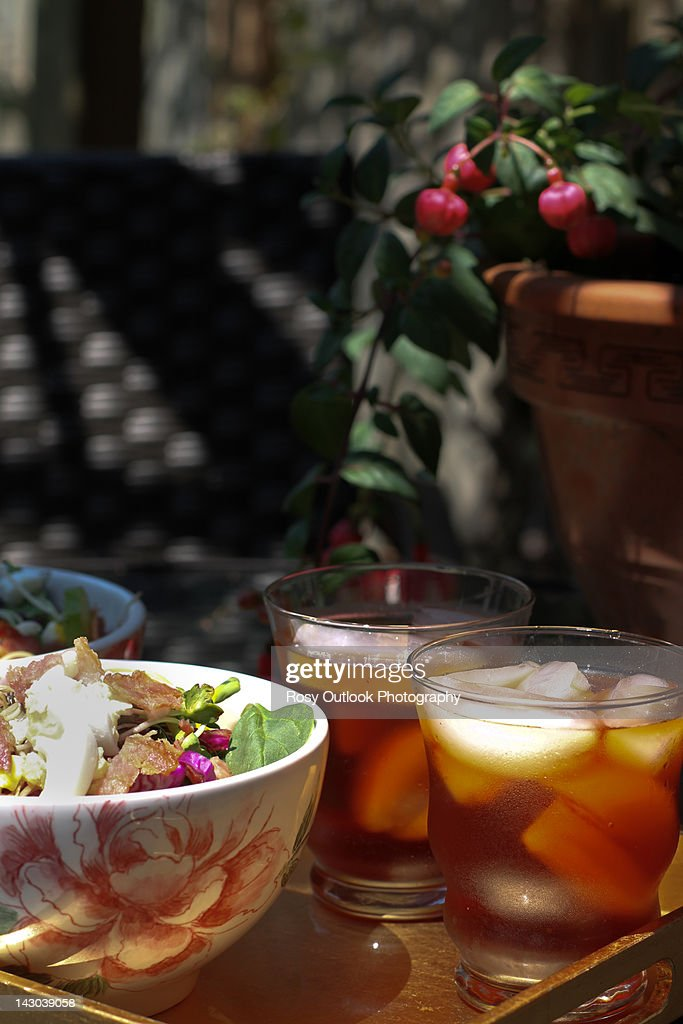 Salad and ice tea under arbor : Stock Photo