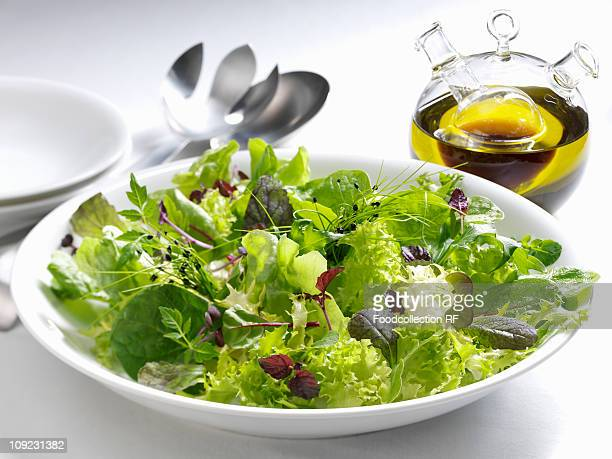 Salad leaves with olive oil, close-up
