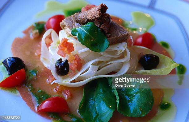 A salad of tuna with marinated tuna belly, black olives and fennel, in Toscana Italian Restaurant on Hong Kong Island.
