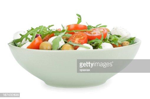 Ensalada de tomates con roqueta y queso mozzarella, : Foto de stock