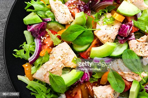 Salad with fish. Fresh vegetable salad with salmon fish fillet. Fish salad with salmon fillet and fresh vegetables on plate : Foto de stock