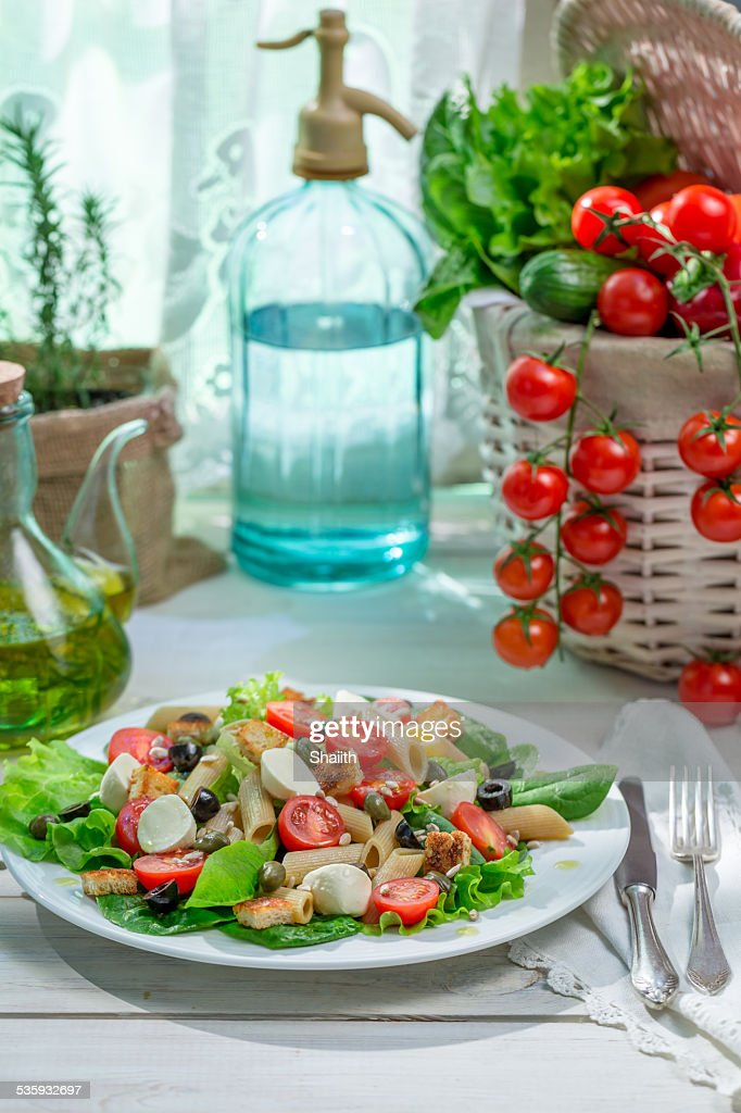 Salad with fresh vegetables and pasta : Stock Photo