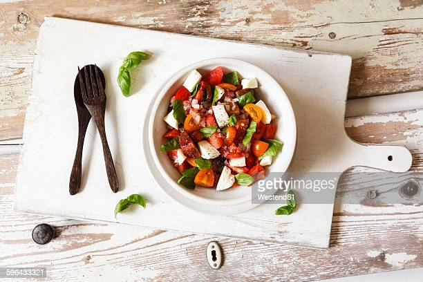 Salad with mozzarella, tomatoes, slices of melon