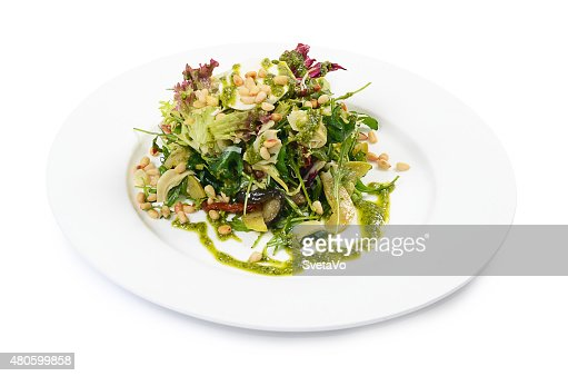 Salad with rucola and pine nuts : Stock Photo