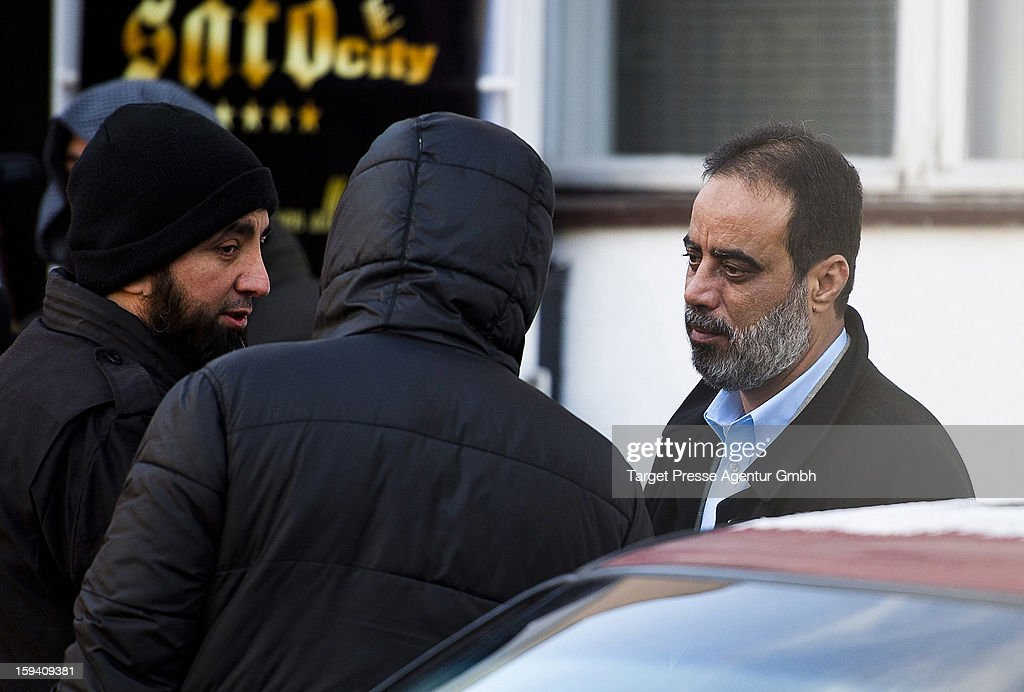 Salafite preacher Ibrahim Abou-Nagie (R) talks to others outside a building where Salafites are holding a benefit rally for Syrian Muslims on January 13, 2013 in Berlin. Two dozen members of 'Pro Deutschland' waited in the centre of Berlin for Salafites who originally planned to hold a public gathering to raise money for Muslims in Syria, which included prominent speakers such as radical Islamic preacher Pierre Vogel. They then moved the event to a private gathering in Neukoelln district. Salafites are an ultra-conservative group of Muslim sunnis with hundreds of members in Berlin and the area around Bonn and cologne. German authorities are keeping a close eye on the group, espacially since clashes that broke out last year in which Salafite demonstrators attacked police and right-wing counter-demonstrators. on January 13, 2013 in Berlin, Germany.