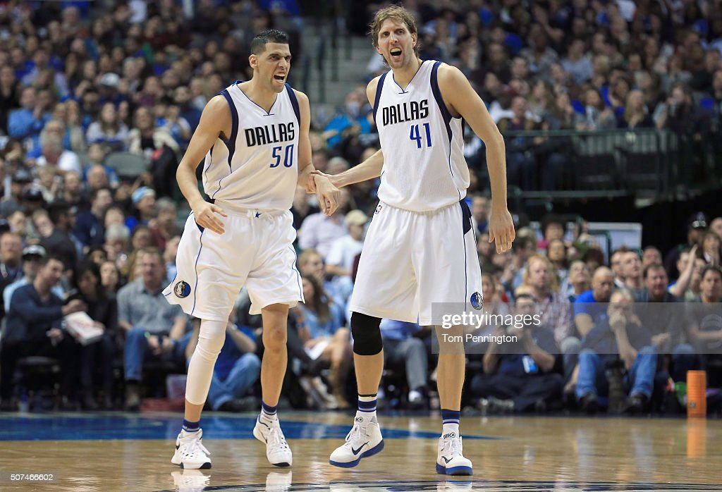 Salah Mejri #50 of the Dallas Mavericks celebrates with Dirk Nowitzki #41 of the Dallas Mavericks after scoring against the Brooklyn Nets in the second half at American Airlines Center on January 29, 2016 in Dallas, Texas.
