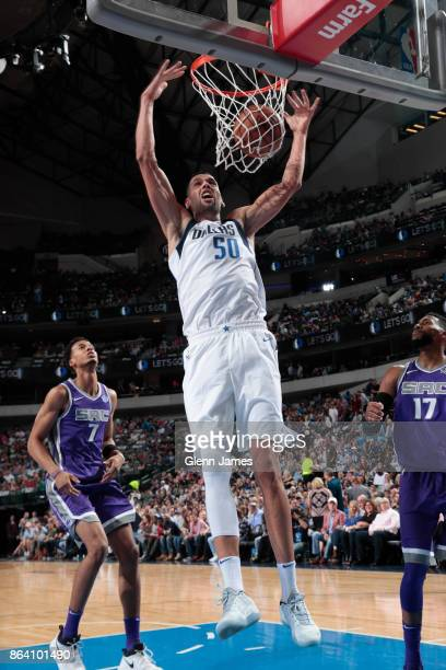 Salah Mejri of the Dallas Mavericks dunks the ball during the game against the Sacramento Kings on October 20 2017 at the American Airlines Center in...