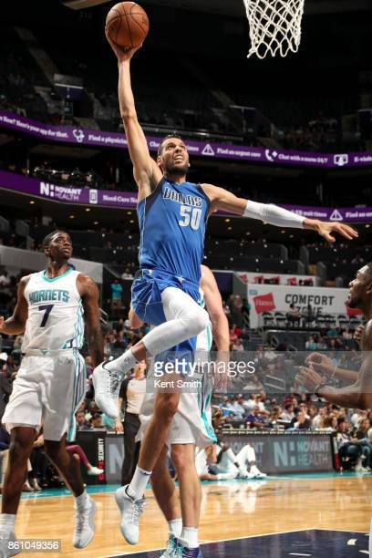 Salah Mejri of the Dallas Mavericks goes to the basket against the Charlotte Hornets on October 13 2017 at Spectrum Center in Charlotte North...