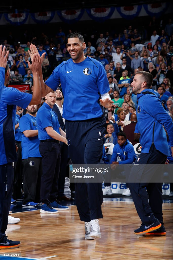 Salah Mejri #50 of the Dallas Mavericks smiles and runs out before the game against the Atlanta Hawks at the American Airlines Center in Dallas, Texas on October 18, 2017.