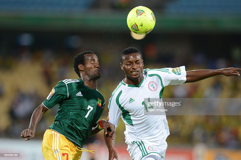 AFRICA - JANUARY 29, Salahdin Said of Ethiopia and Godfrey Oboabona of Nigeria (R) in action during the 2013 African Cup of Nations match between Ethiopia and Nigeria at Royal Bafokeng Stadium on January 29, 2013 in Rustenburg, South Africa.