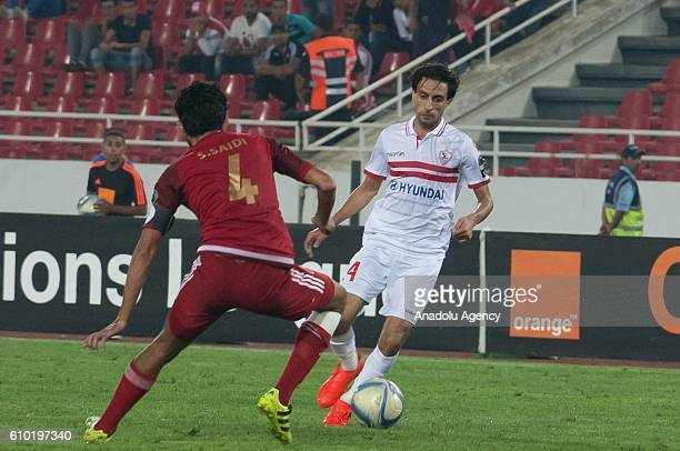 Salaheddine Saidi of Wydad Casablanca and Aly Hefny Salama of Zamalek vie for the ball during the semifinal match of CAF Champions League between...