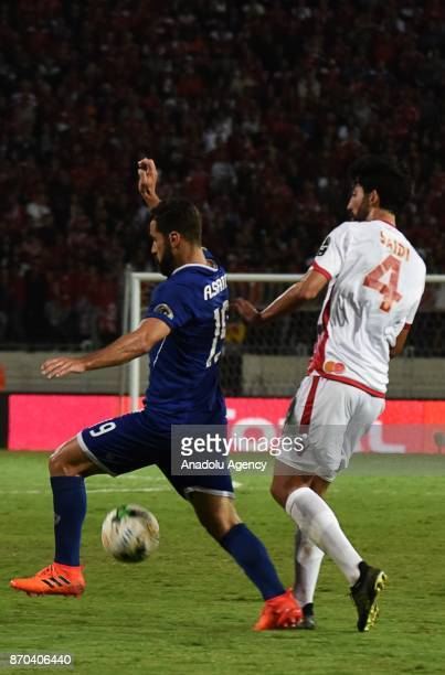 Salaheddine Saidi of Wydad Casablanca in action against Abdallah Said of Al Ahly during the CAF African Champions League match Wydad Casablanca and...