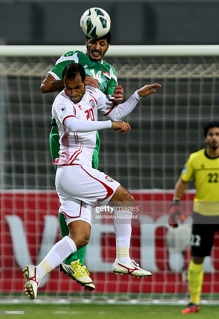 Salam Shakir (top) of Iraq vies with Ali Salem of UAE during the 21st Gulf Cup's final between United Arab Emirates (UAE) and Iraq on January 18, 2013 in Manama. United Arab Emirates won 2-1 against Iraq. AFP PHOTO/MARWAN NAAMANI