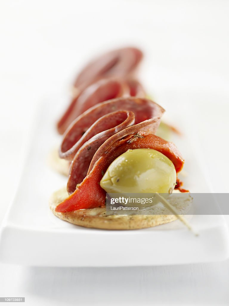 Salami canapes with roasted peppers stock photo getty images for Types of canape bases