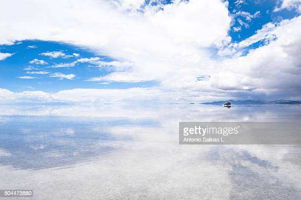 Salar de Uyuni in Bolivia . Sky reflected