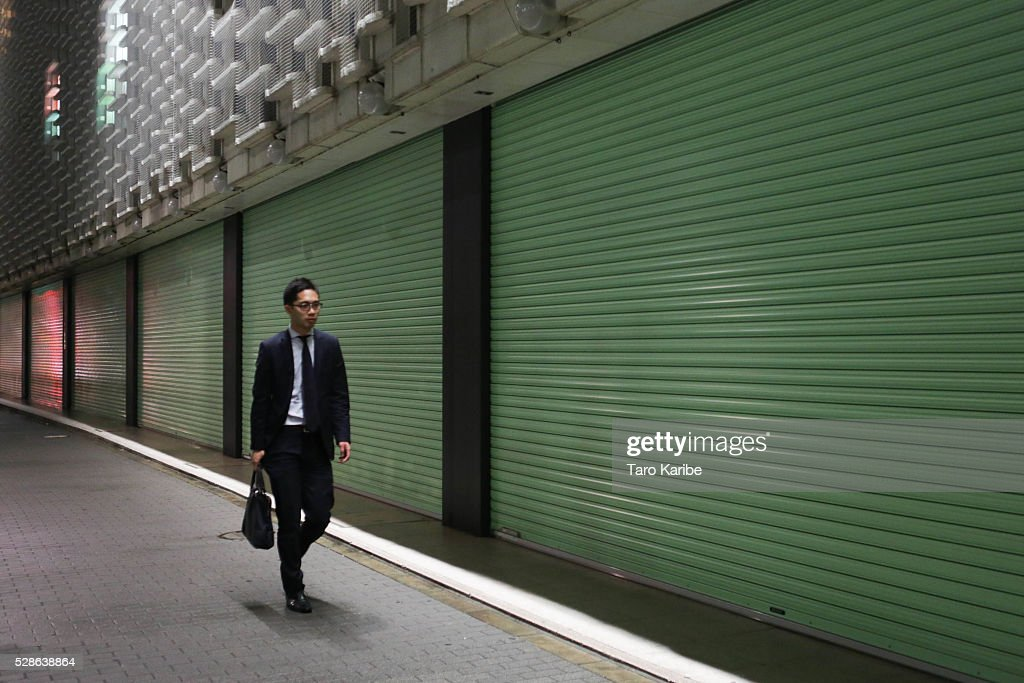 A Salary man walks after five on May 06, 2016 in Tokyo.