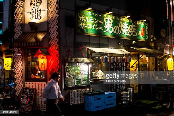 Salary men enjoy dinner at a local restaurant after finishing work in Shimbashi on October 16 2015 in Tokyo Japan
