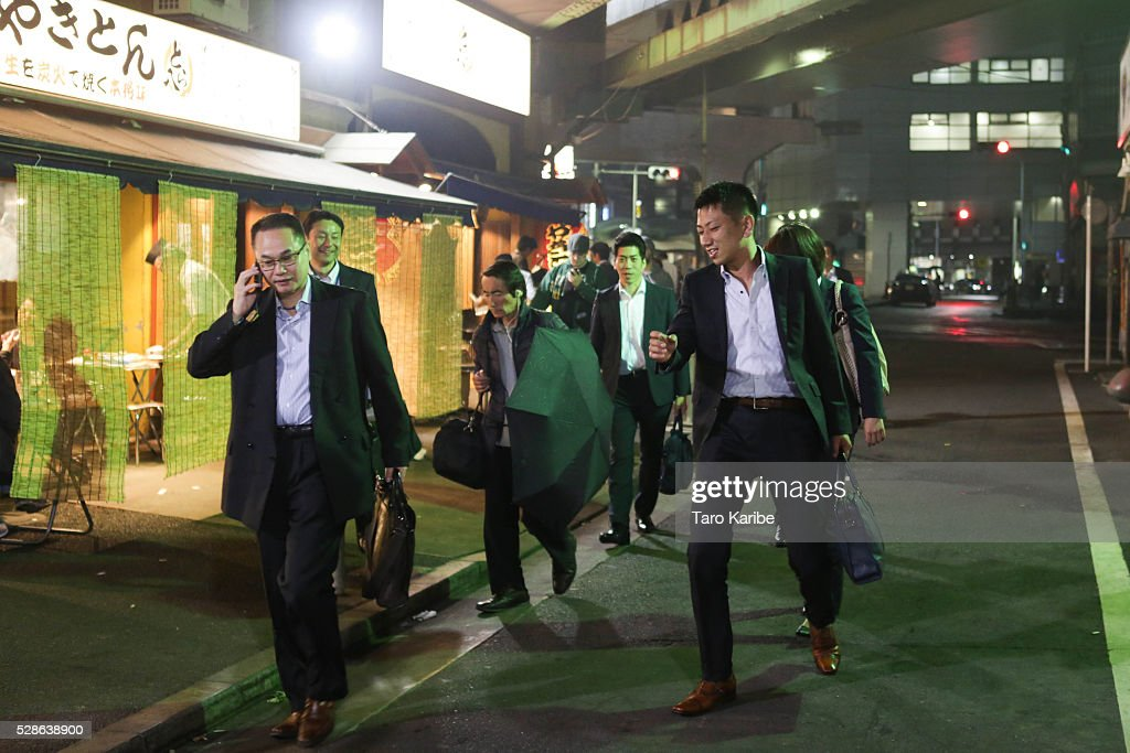Salary men enjoy drinking and walking on bar street after five on May 06, 2016 in Tokyo.