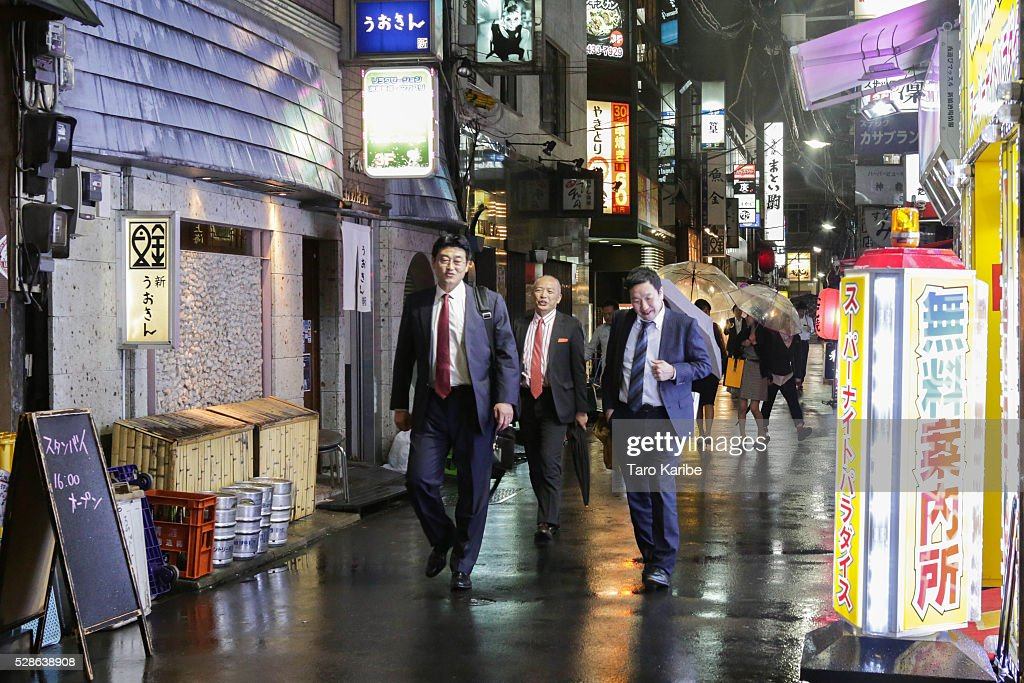 Salary men enjoy drinking on a bar street after five on May 06, 2016 in Tokyo.