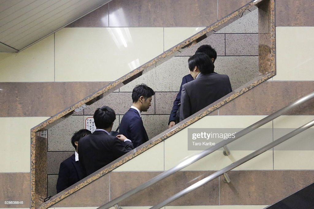 Salary men going back home after five on May 06, 2016 in Tokyo.