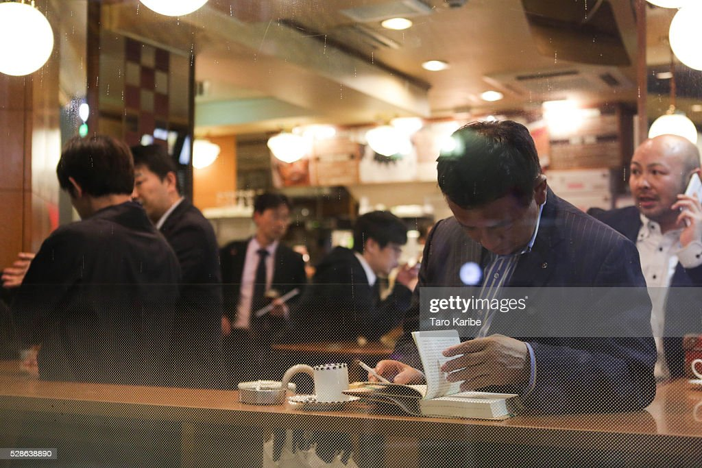 Salary men spend their time at cafe after five on May 06, 2016 in Tokyo.