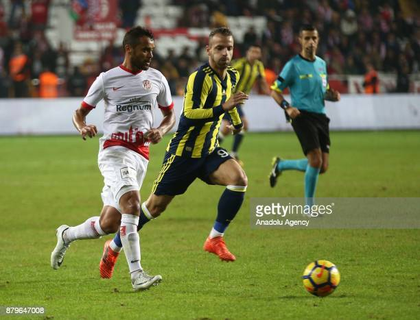 Saldado of Fenerbahce in action against Charles of Antalyaspor during the Turkish Super Lig match between Antalyaspor and Fenerbahce at Antalya...
