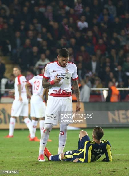 Saldado of Fenerbahce lays on the ground after getting injured during the Turkish Super Lig match between Antalyaspor and Fenerbahce at Antalya...