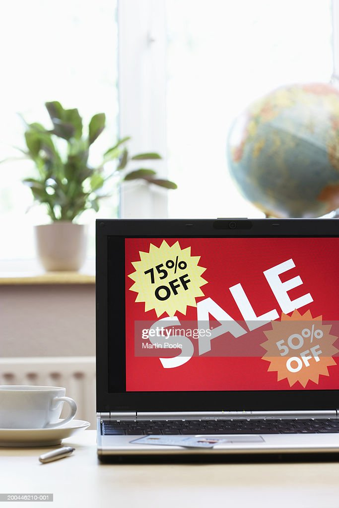 Sale advertisment on screen of laptop : Stock Photo