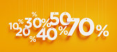 "Percentage signs with white strings over yellow background. Horizontal composition with copy space. Clipping path is included. Great use for shopping and Valentine's Day Christmas and Mother""s Day rel"