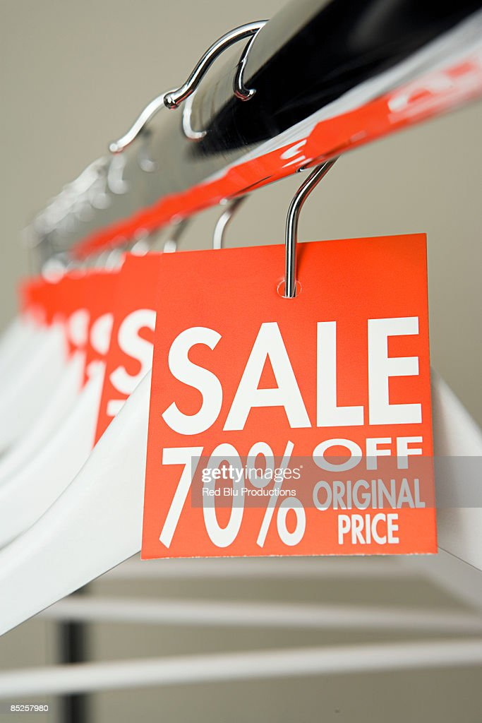 Sale labels on clothes hangers : Stock Photo