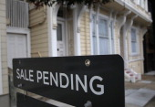A sale pending sign is posted in front of a home for sale on July 17 2014 in San Francisco California According to a report by DataQuick the median...