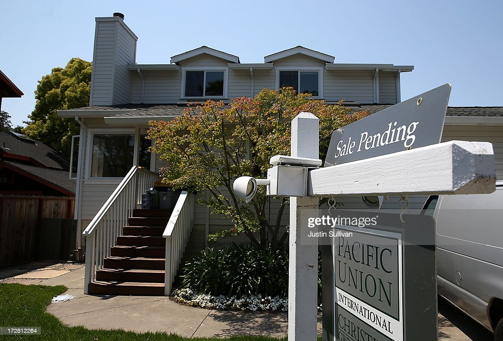 A sale pending sign is posted in front of a home for sale on July 2, 2013 in San Anselmo, California. According to a report by real estate data provider CoreLogic, home prices in the U.S. surged 12.2 percent in May compared to a year ago, the largest increase in seven years.