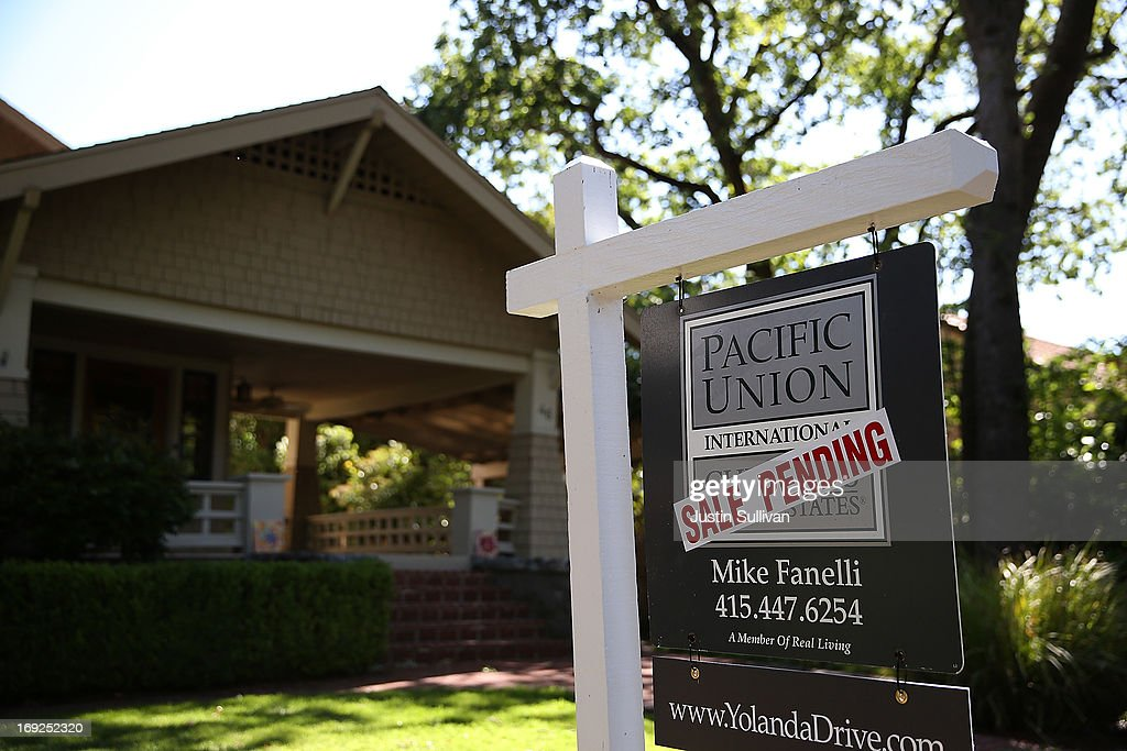 A sale pending sign is posted in front of a home for sale on May 22, 2013 in San Anselmo, California. According to a report by the National Association of Realtors, sales of existing homes inched up 0.6% to a seasonally adjusted annual rate of 4.97 million, up from 4.94 million in March, the highest level since 2009.