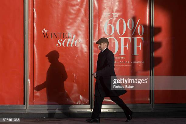 Sale reductions at a branch of UK retailer Marks Spencer on Bishopsgate in the City of London With his own shadow and that of a nearby traffic light...