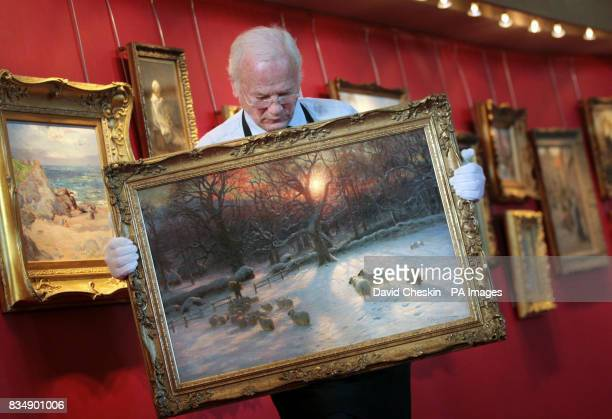 Sale room officer Sidney Drew holds a famous painting by Scottish artist Joseph Farquharson that is to be auctioned by Lyon Turnbull in Edinburgh It...