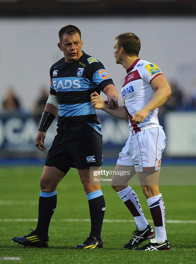 Sale scrum half Dwayne Peel (r) has words with Blues player Matthew Rees during the pre-season friendly match between Cardiff Blues and Sale Sharks at Cardiff Arms Park on August 23, 2013 in Cardiff, Wales.
