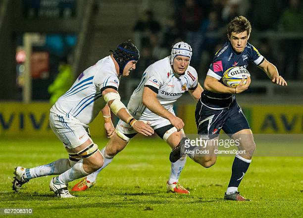 Sale Sharks' AJ MacGinty gets away from Exeter Chiefs Mitch Lees and Thomas Waldrom during the Aviva Premiership match between Sale Sharks and Exeter...