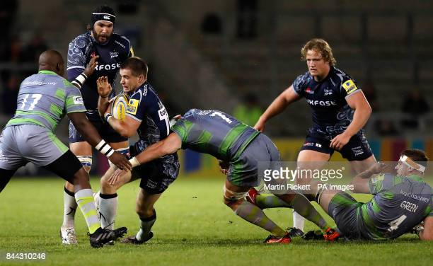 Sale Sharks' AJ MacGinty is tackled by Newcastle Falcon's Sami Mavinga and Newcastle Falcon's Will Welch right0 during the Aviva Premiership match at...