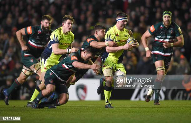 Sale Sharks' Ben Curry is tackled by Leicester Tigers' Will Evans and Mike Williams during the Aviva Premiership match at Welford Road Leicester