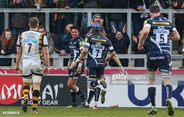 Sale Sharks' Denny Solomona celebrates with teammates after scoring his second try during the Aviva Premiership match between Sale Sharks and Wasps...