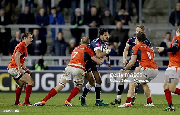 Sale Sharks Denny Solomona is tackled by Saracens Schalk Burger during the European Champions Cup pool three mach at the AJ Bell Stadium Salford