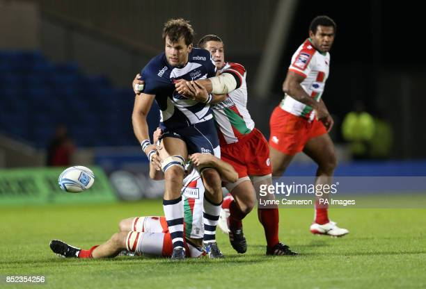 Sale Shark's Ross Harrison and Biarritz's Tanguy Molcard during the Amlin Challenge Cup Pool One match at the AJ Bell Stadium Salford