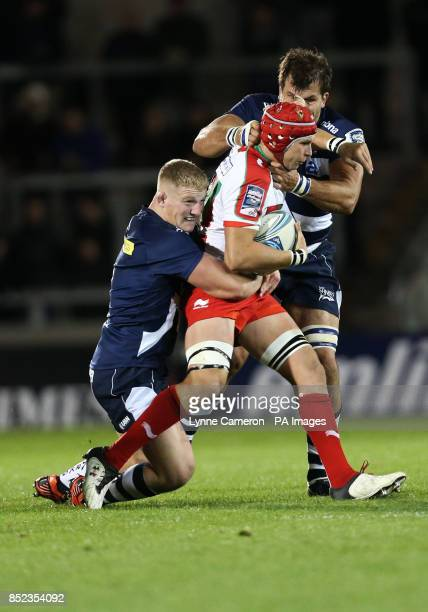Sale Shark's Ross Harrison and Kirill Kulemin tackle Biarritz's Tanguy Molcard during the Amlin Challenge Cup Pool One match at the AJ Bell Stadium...
