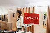 50% OFF Sale Sign in Clothing Store