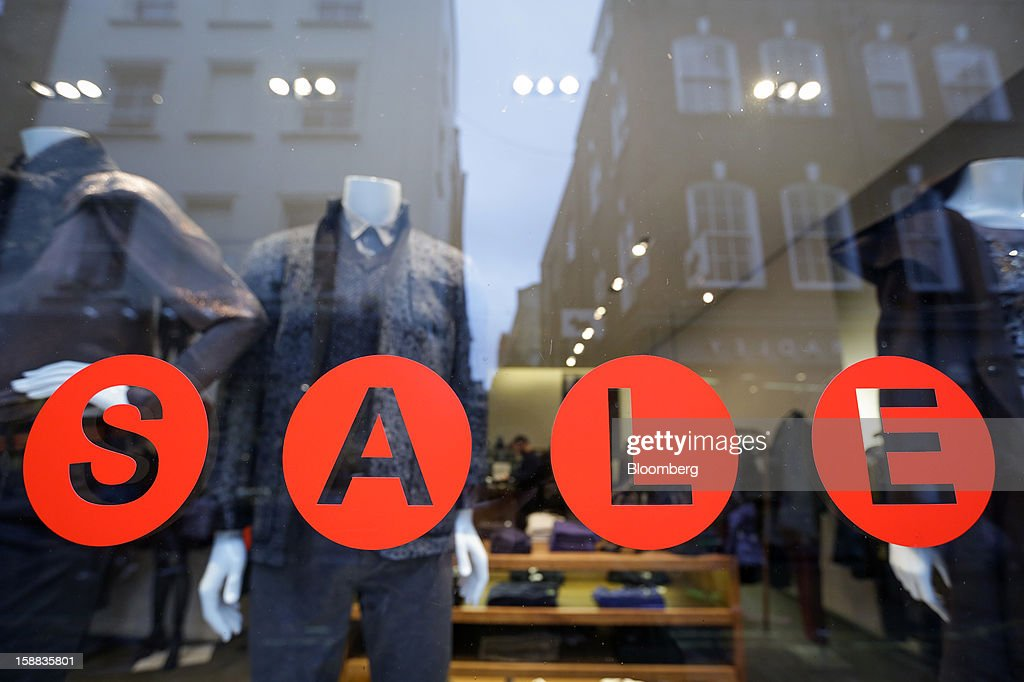 A sale sign is seen in the window of a Ted Baker Plc store in the Covent Garden district of London, U.K., on Monday, Dec. 31, 2012. The number of Britons making shopping trips for post-holiday bargains barely increased on the day after Christmas as more people sought discounts online. Photographer: Jason Alden/Bloomberg via Getty Images