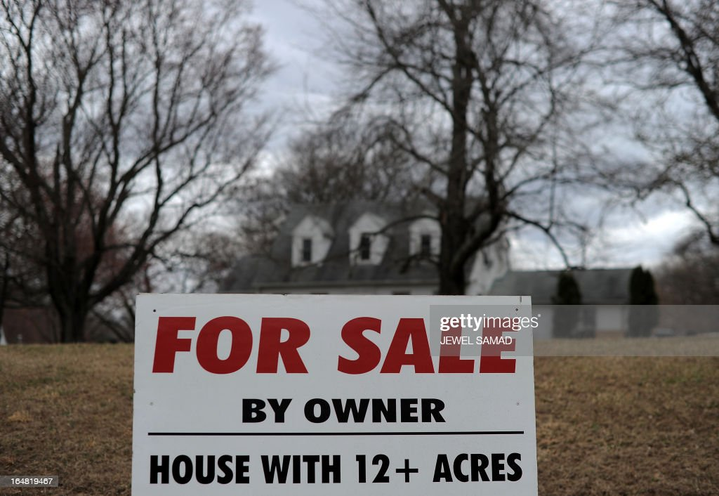 A sale sign is seen posted in front of a house in Silver Spring Maryland on March 28 2013 The US economy grew more strongly than initially thought in...