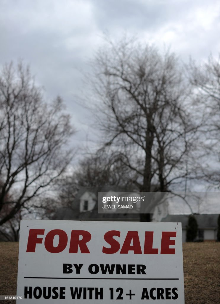A sale sign is seen posted in front of a house in Silver Spring, Maryland, on March 28. 2013. The US economy grew more strongly than initially thought in the fourth quarter last year but was still moving at a sluggish 0.4 percent annual pace, the Department of Commerce said on March 28. AFP PHOTO/Jewel Samad