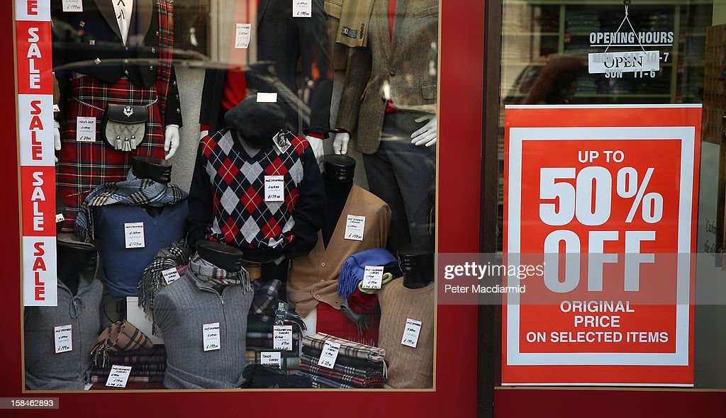 Sale signs are displayed in a shop window in Oxford Street on December 17, 2012 in London, England. Thousands of shoppers are expected in London's west end in the hunt for Christmas bargains in the next week.
